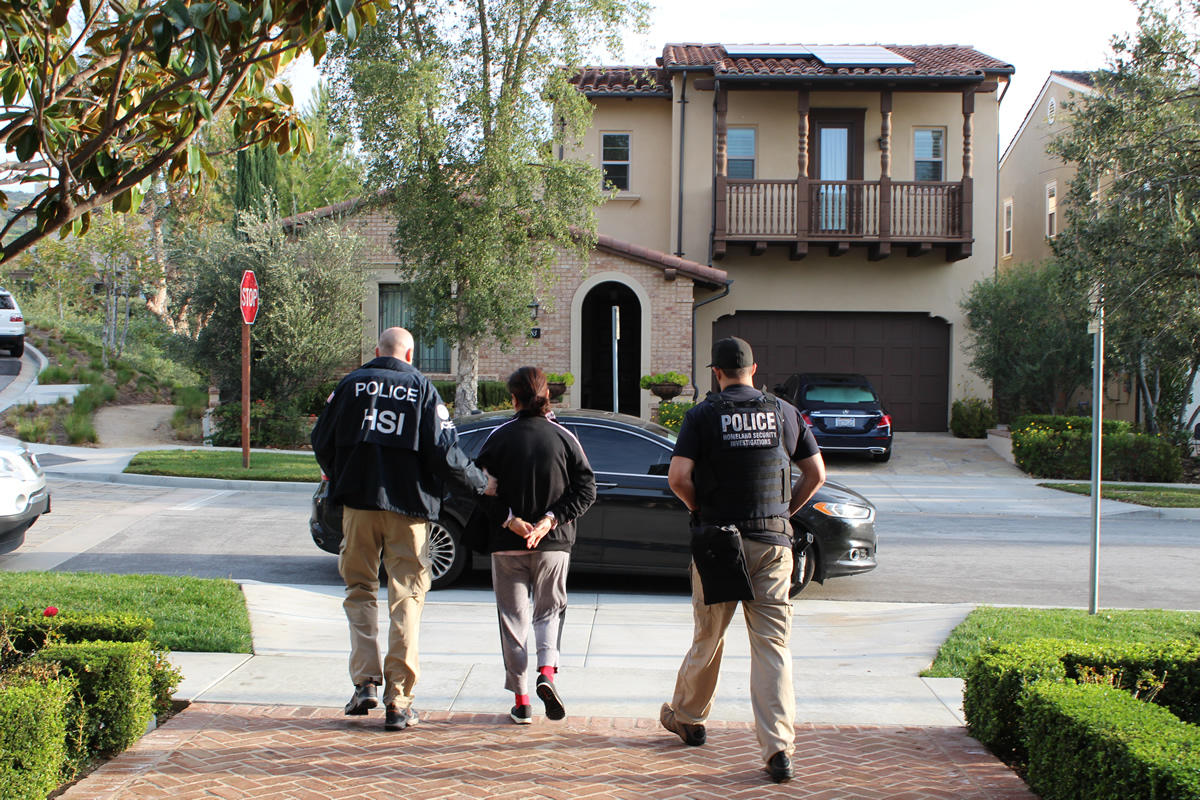 Frederal Homeland Security Investigations (HSI) agents escort a  birth-tourism suspect. (All photos courtesy of HSI)