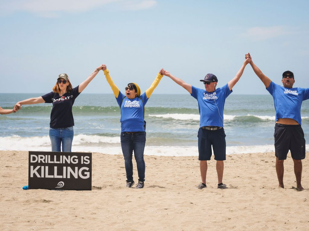 Hands Across the Sand in Huntington Beach Becomes Line in the Sand Against Oil and Gas Drilling Off OC Coast
