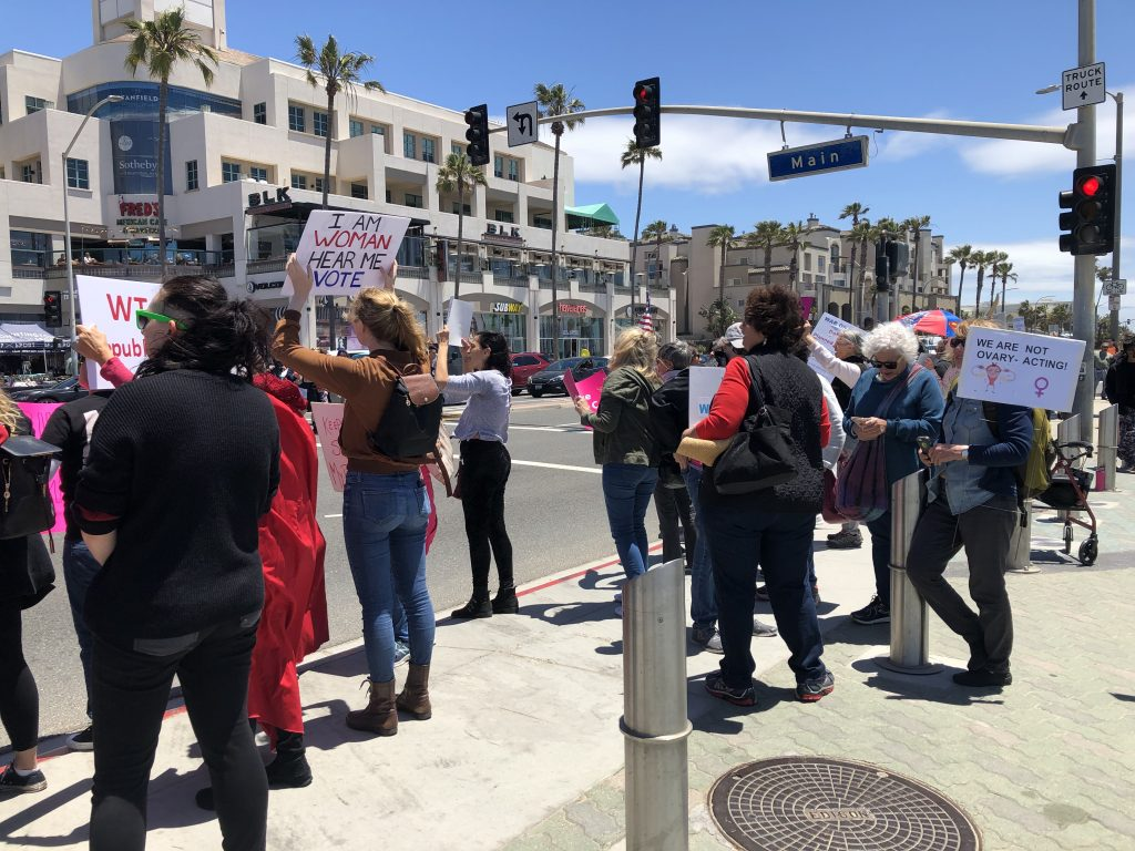 100+ Rally at HB Pier to Protest Abortion Bans