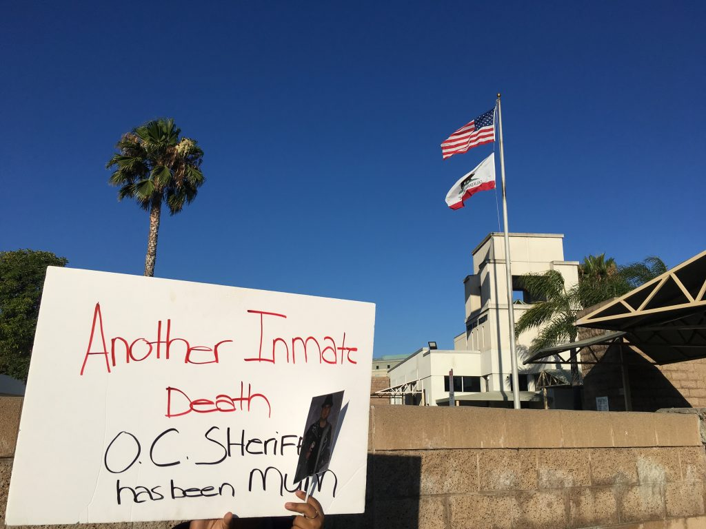 Vigil for OC Jail Inmate Deaths Sheds Light On Systemic Issue