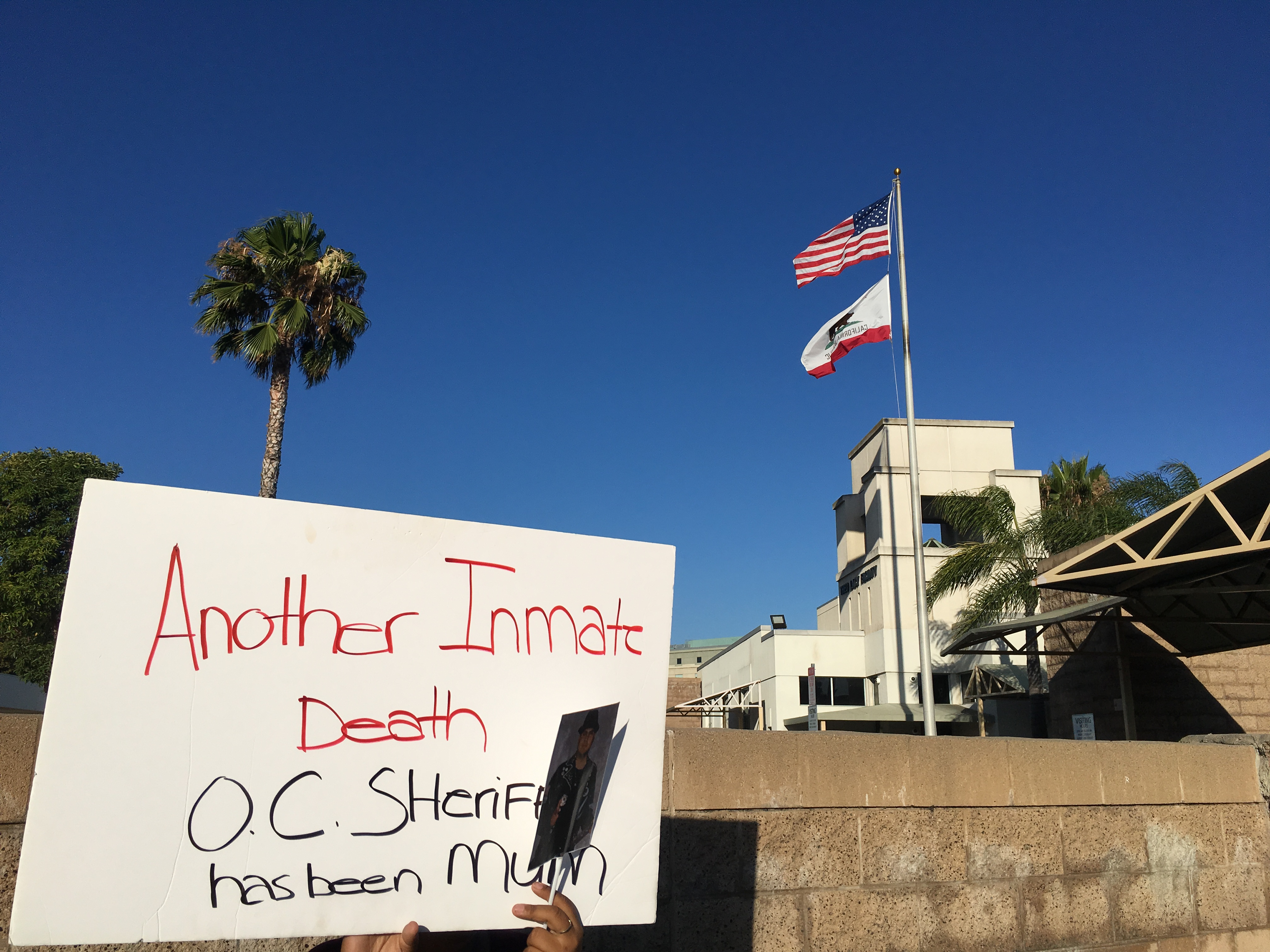 Vigil for OC Jail Inmate Deaths Sheds Light On Systemic